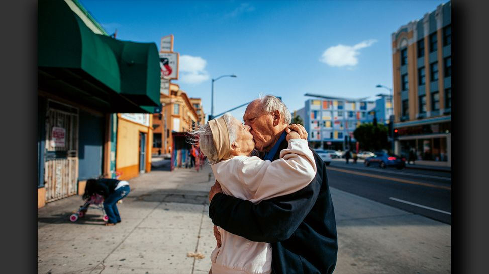 Senior Love Triangle - Jeanie and Will kiss on the street in Los Angeles, California; © Isadora Kosofsky