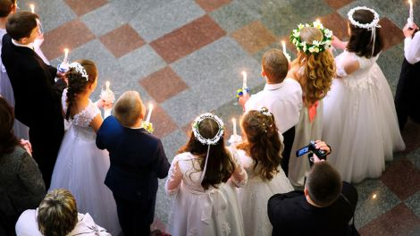 First holy communion in church, many children