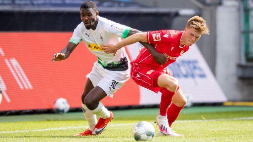 Marius Bülter (r.) im Spiel gegen Borussia Mönchengladbach. Quelle: dpa/Moritz Müller