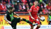 Unions Robert Andrich (r.) im Zweikampf mit Wolfsburgs Daniel Ginczek (imago images/Matthias Koch)