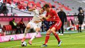 Petar Musa (FCU) und Josip Stanisic (FCB) im Zweikampf um den Ball (Quelle: Imago Images / Matthias Koch)