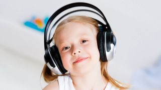 Pretty girl listening to music on headphones